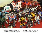 Small photo of KUALA LUMPUR, MALAYSIA -MARCH 18, 2017: Transformers television cartoon and film action figure display on table.