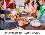 close up a man cuts a pizza... | Shutterstock . vector #625469297