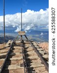 Small photo of Train tracks atop Pikes Peak end abruptly at the edge of a cliff high above the valley below