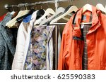 clothes in a cloakroom | Shutterstock . vector #625590383