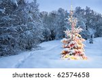 Christmas Tree In Snow With...