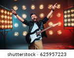 male rock star with electro... | Shutterstock . vector #625957223