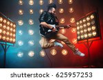 male performer with electro... | Shutterstock . vector #625957253