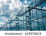 Greenhouses Against The Blue Sky