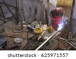 Welder Connects Two Pieces Of...