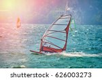 windsurfer surfing the wind on... | Shutterstock . vector #626003273