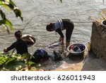Women washing clothes in a river