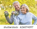 old couple is doing sports on... | Shutterstock . vector #626074397