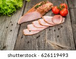 veal roast with vegetables. on... | Shutterstock . vector #626119493