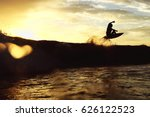 surfer on the wave. the surfer... | Shutterstock . vector #626122523