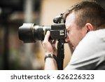 studio photographer in action.... | Shutterstock . vector #626226323