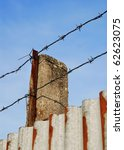 barbed wire on the metal wall... | Shutterstock . vector #62623075