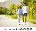 Young Asian Couple Walking On...