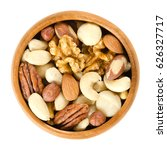 raw mixed nuts in wooden bowl.... | Shutterstock . vector #626327717