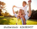 happy young woman with child... | Shutterstock . vector #626383457
