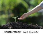 children's hand watering a... | Shutterstock . vector #626412827