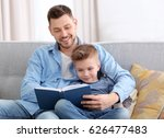 dad and son reading interesting ... | Shutterstock . vector #626477483