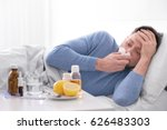young ill man lying in bed at... | Shutterstock . vector #626483303