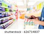 hand holding smart phone over... | Shutterstock . vector #626714837