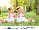 happy twin sisters children.... | Shutterstock . vector #626728217