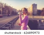 young woman drinking water and... | Shutterstock . vector #626890973