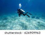 scuba diver swim through coral... | Shutterstock . vector #626909963