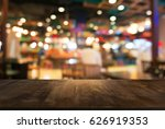 empty dark wooden table in... | Shutterstock . vector #626919353