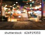 empty dark wooden table in... | Shutterstock . vector #626919353