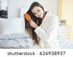 Woman Combing Her Long Brown...