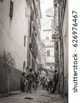 Small photo of CONSTANTINE, ALGERIA - March 28, 2017: Algerian kids playing street football in the narrow street of Constantine old town, Algeria