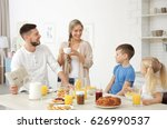 happy family having breakfast... | Shutterstock . vector #626990537