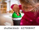 little girl putting used...   Shutterstock . vector #627008447