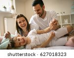 parents having fun with their... | Shutterstock . vector #627018323