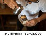 coffee in waffle cone | Shutterstock . vector #627023303