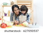 mom and child cooking and... | Shutterstock . vector #627050537