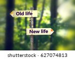 signpost in a park with arrows... | Shutterstock . vector #627074813