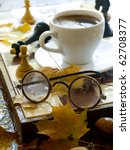Glasses And Cup Of Coffee On...