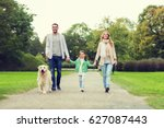 Stock photo family pet domestic animal and people concept happy family with labrador retriever dog walking 627087443