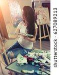 female artist working on...   Shutterstock . vector #627089213