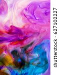 Small photo of Abstract artistic photograph of a staged action painting scene. Liquid Colors ink drops paint depth. Colorful blend of water colors on white background, violet, white, blue, and, yellow hue.