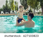 father and son funny in  water... | Shutterstock . vector #627103823