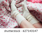 white socks on feet with pink... | Shutterstock . vector #627143147