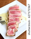 Small photo of large generous slices of seared Ahi tuna slices