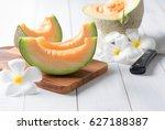 fresh sweet orange melon on... | Shutterstock . vector #627188387