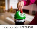 little girl putting used...   Shutterstock . vector #627223307