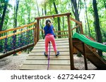 Pose Of A Young Child Climbing...