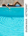 young woman lies near the pool | Shutterstock . vector #627426467