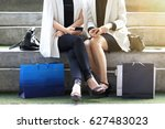 women sitting outdoors with... | Shutterstock . vector #627483023