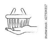 hand holding shopping basket... | Shutterstock .eps vector #627534317
