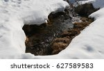 snow is melting on a slope in... | Shutterstock . vector #627589583